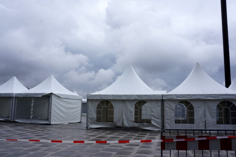 Hauptbahnhof-tents-gray-clouds